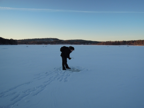 Ice fishing in the middle of the lake